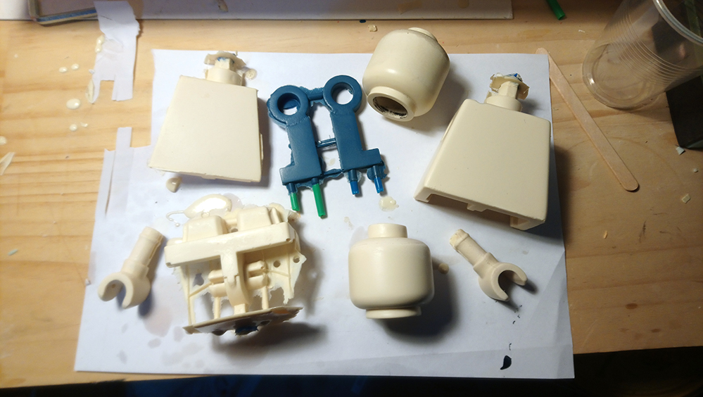 lego minifigure parts cast in silicone with flashing and sprues
